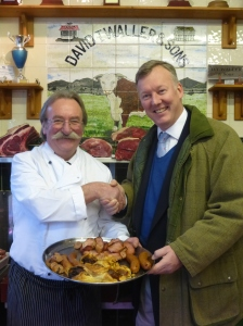 Bill Wiggin MP with Butcher Dave Waller and a magnificent salver of breakfast at the event organised by Ledbury Food Group.